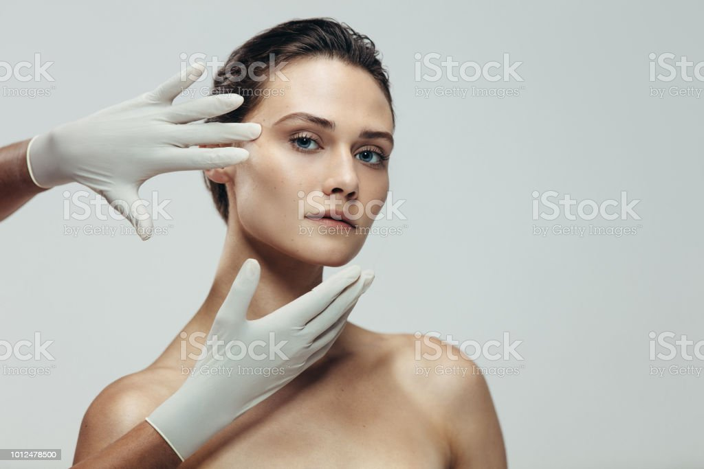 Face skin check before plastic surgery stock photo