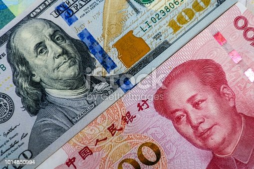 istock Face to face of US dollar banknote and China Yuan banknote for 2 biggest economic in the world which now United states of America and China have war trade. 1014850994