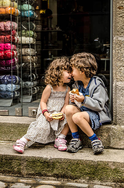 face to face - little girls little boys kissing love stock photos and pictures