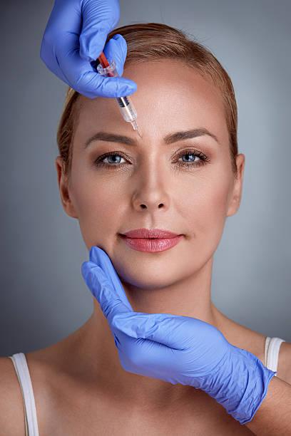 face treatment of correction wrinkles - nadeldesigns stock-fotos und bilder