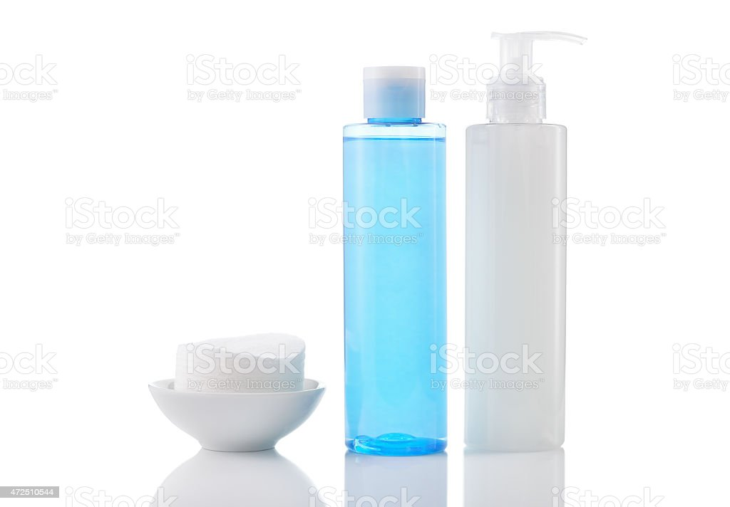 Face wash cleansing gel, toner and cotton cleansing pads isolate stock photo