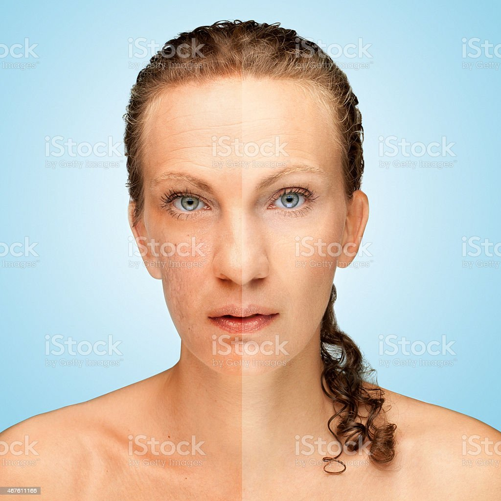 A face with one side looking old while other looks beautiful stock photo
