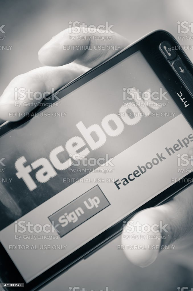 Facebook access log-ing on smarthphone stock photo