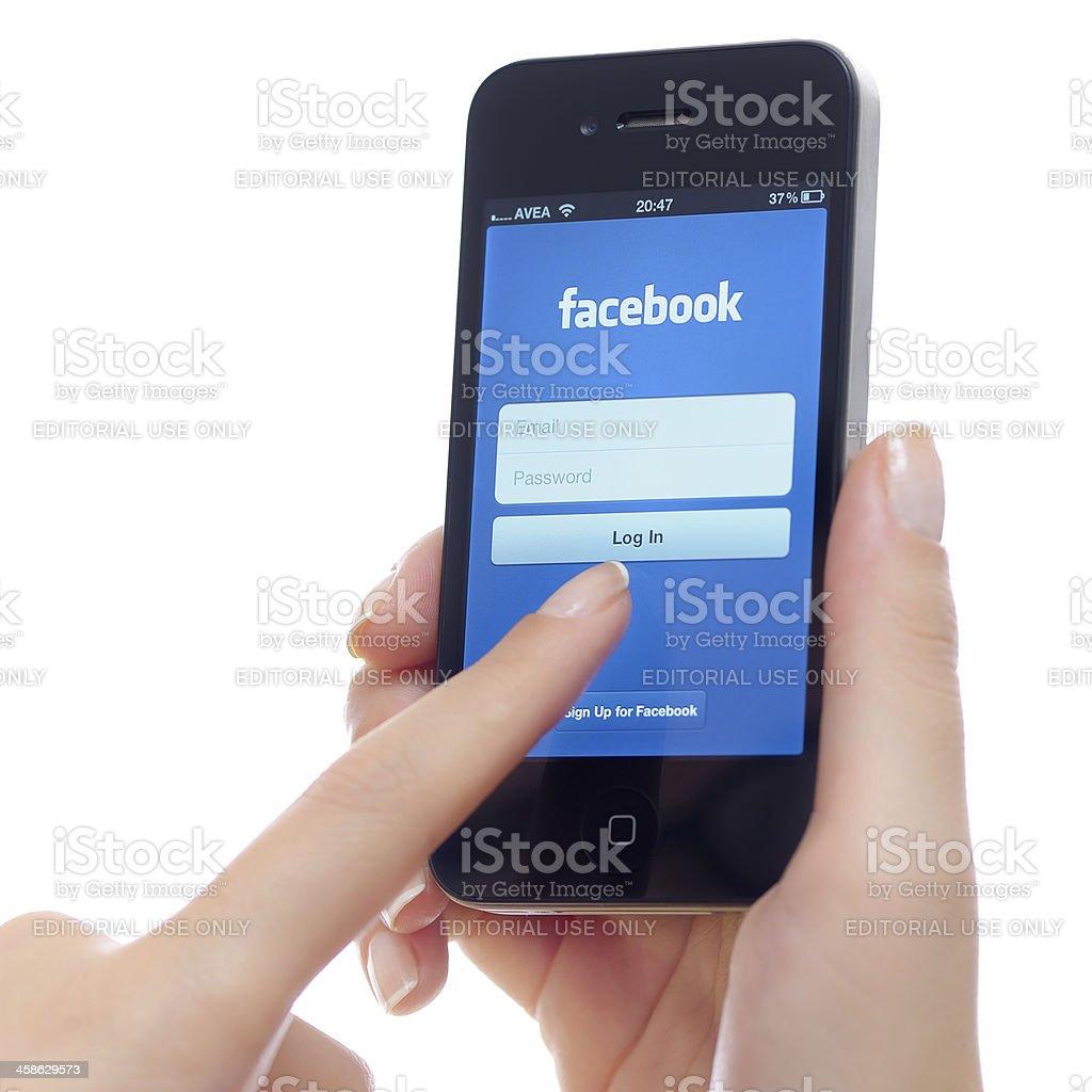 Facebook app on Apple iPhone 4 stock photo