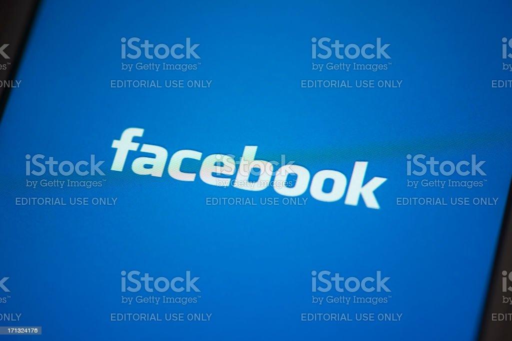 Facebook App on Apple iPhone 4s Screen stock photo