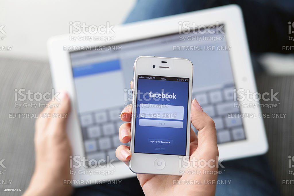 Facebook app on iPhone royalty-free stock photo