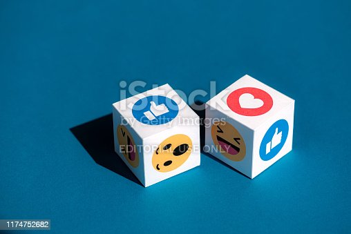 istock Facebook Emoticons Printed on a Cubes 1174752682