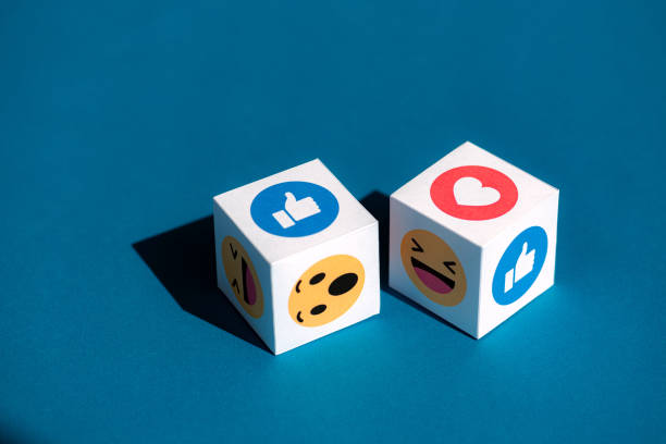 Facebook Emoticons Printed on a Cubes stock photo