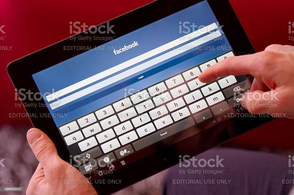 Facebook homepage displayed on an tablet. royalty-free stock photo