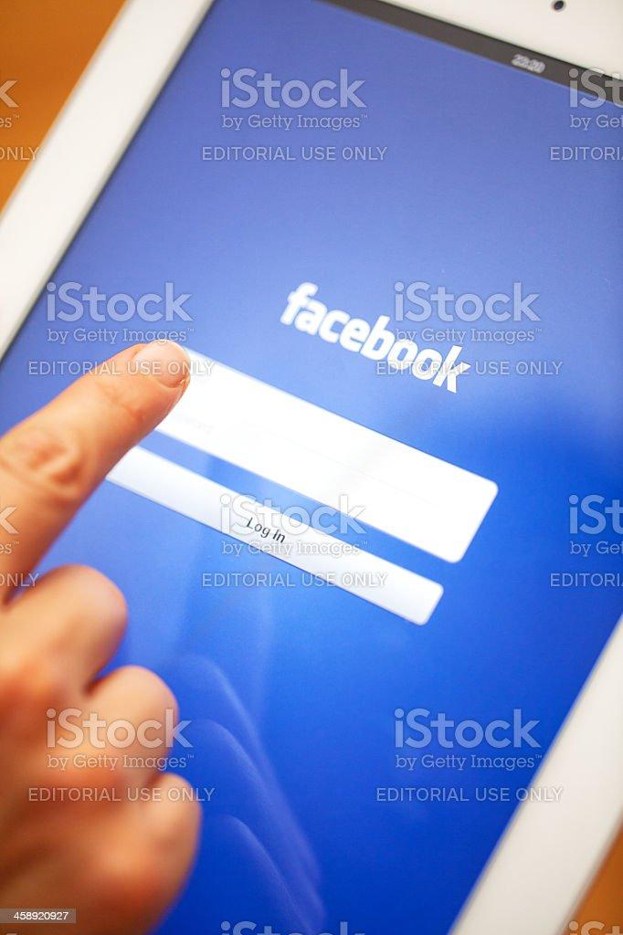 Facebook homepage displayed on Apple iPad 3. royalty-free stock photo