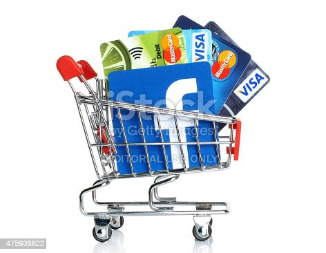 istock Facebook logo into shopping cart with cards Visa and MasterCard 475938622