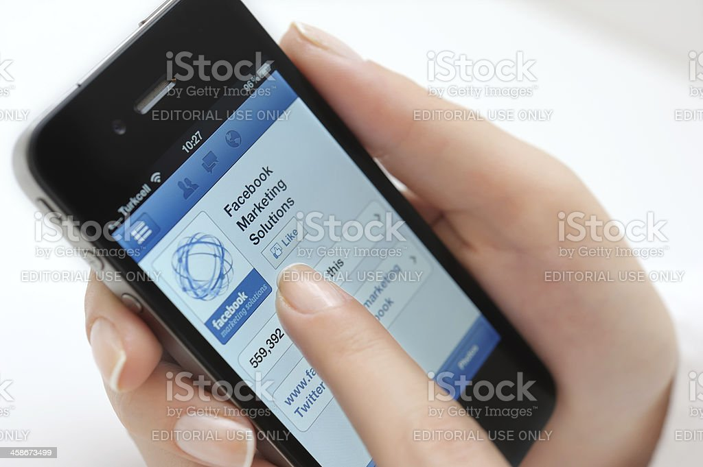 Facebook marketing solutions on iPhone stock photo