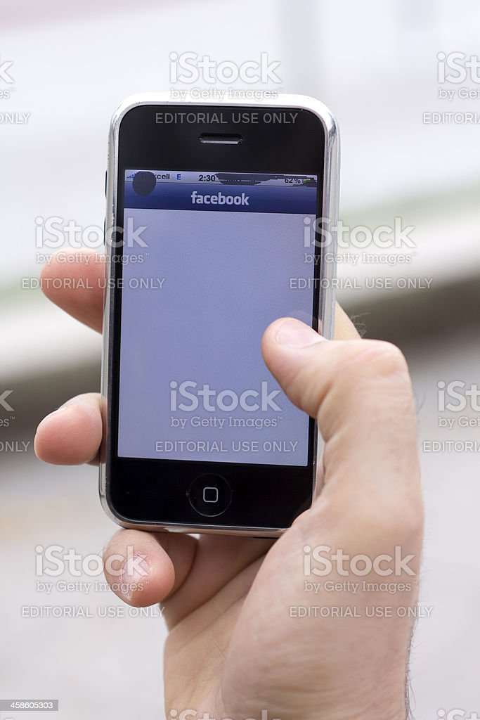 Facebook on an Apple Mobile phone royalty-free stock photo