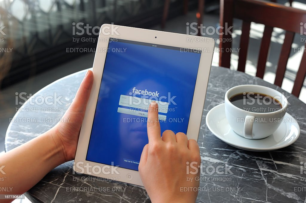 Facebook on iPad 3 stock photo
