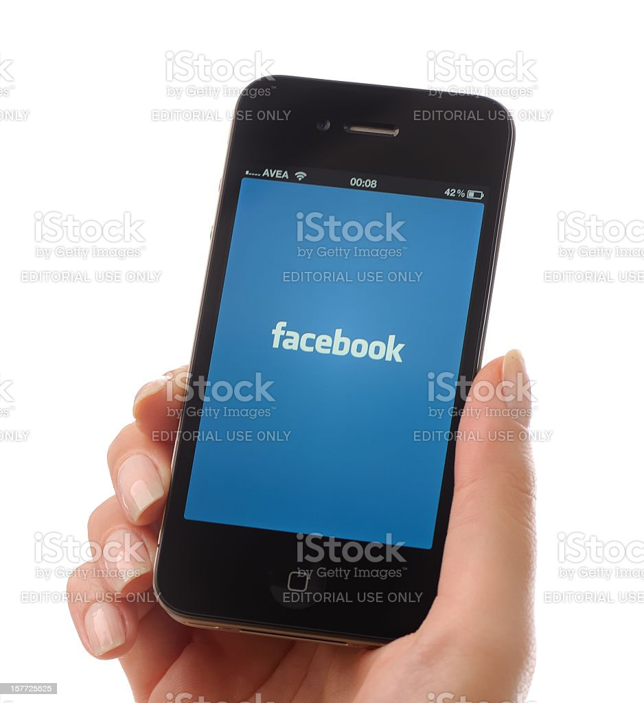 Facebook on iPhone 4 stock photo
