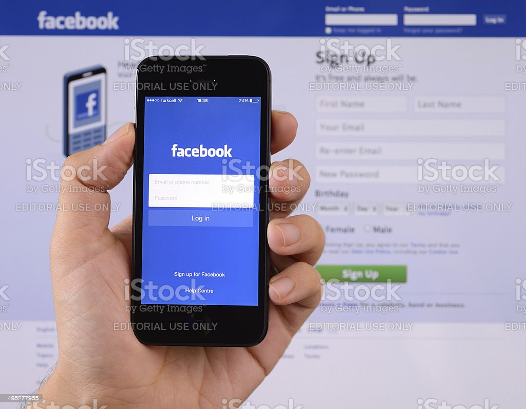 Facebook on iPhone smartphone stock photo