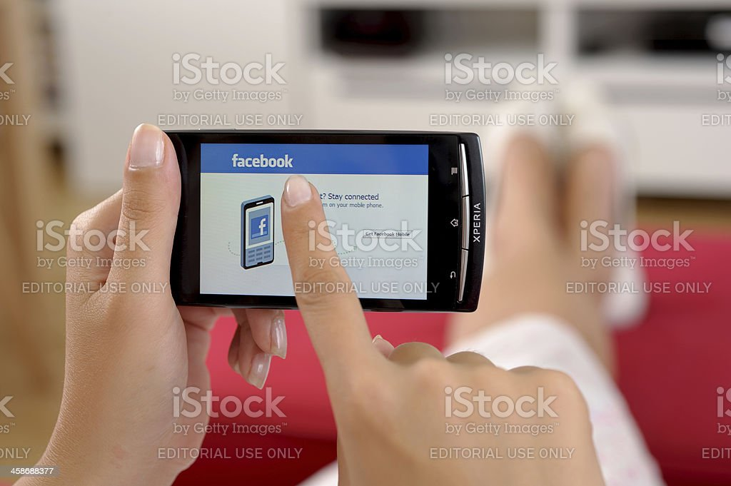 Facebook on mobile phone royalty-free stock photo