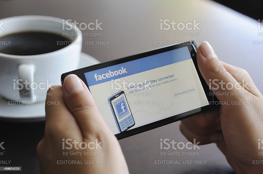 Facebook on smart phone stock photo