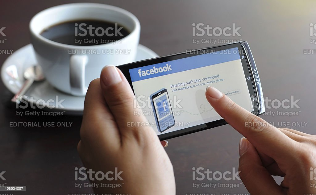 Facebook on smart phone royalty-free stock photo