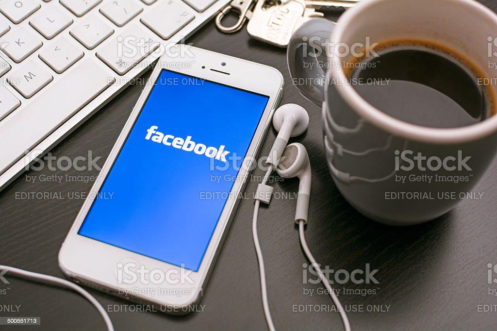 Facebook on smartphone stock photo