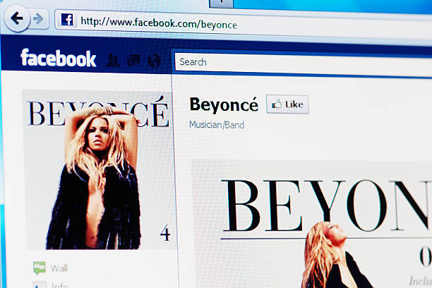 Facebook page of Beyoncé on RGB laptop monitor stock photo