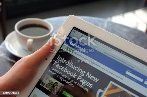 Astanbul, Turkey - April 16, 2012: Woman hands holding The New iPad displaying