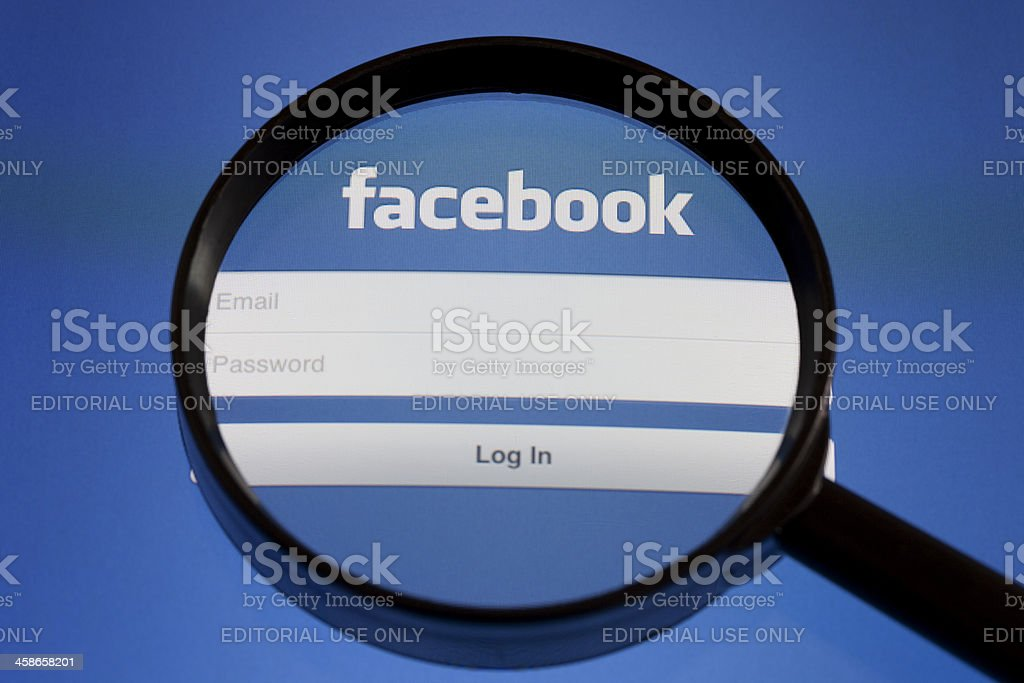Facebook Under Magnifying Glass royalty-free stock photo