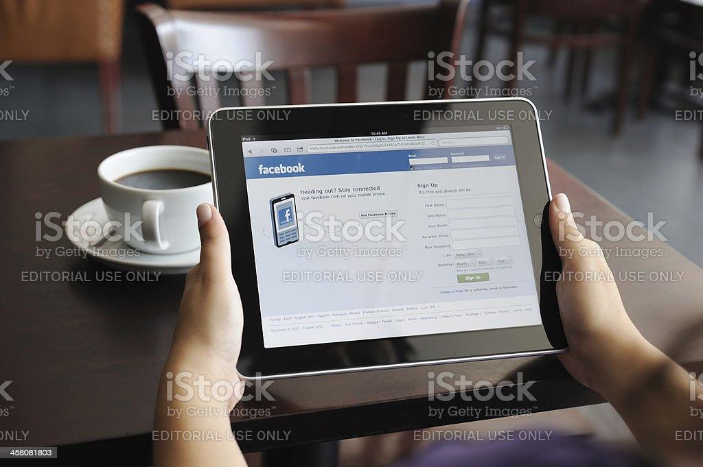 Facebook web page on iPad Apple Digital Tablet stock photo