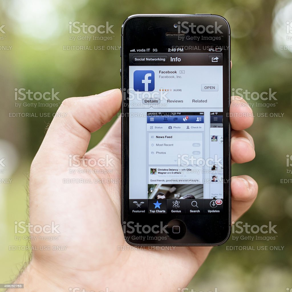 Facebook web pages on smarthphone Iphone 5 royalty-free stock photo