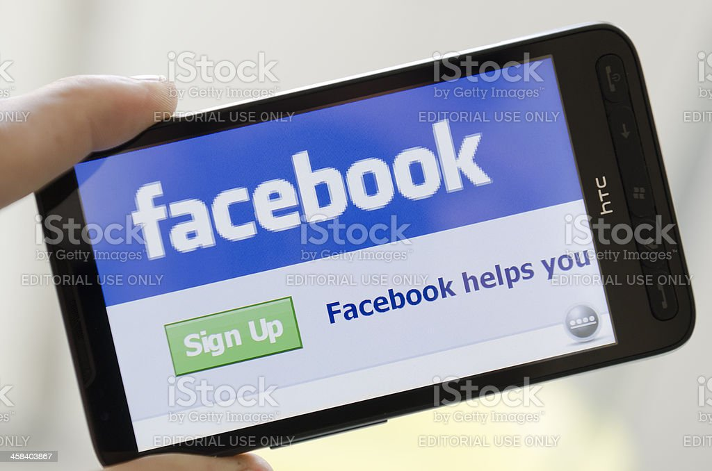 Facebook web pages on smarthphone stock photo
