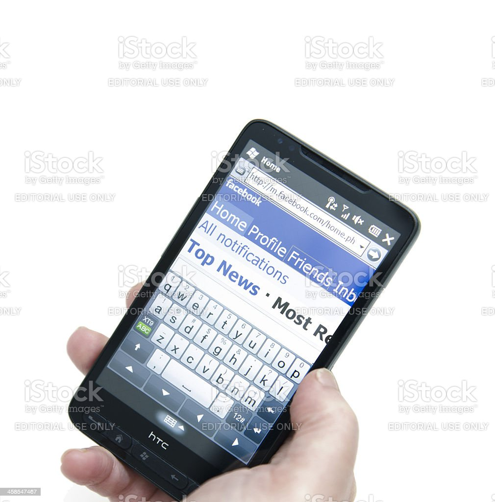 Facebook web pages on smarthphone royalty-free stock photo