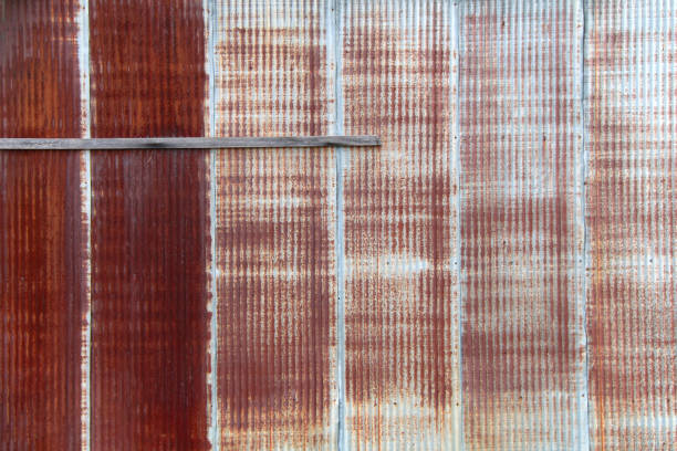 faced rusted red metal factory warehouse wall stock photo