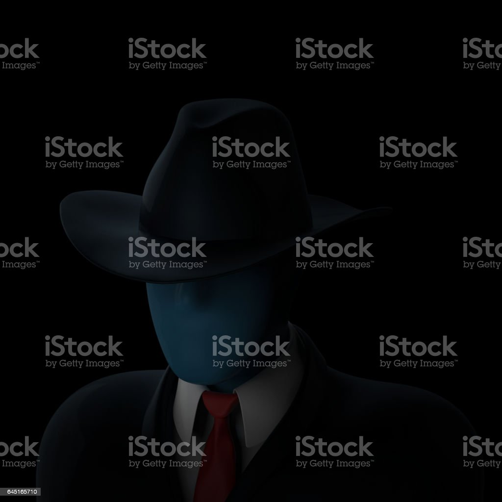 Faceless anonymous computer hacker in darkness stock photo