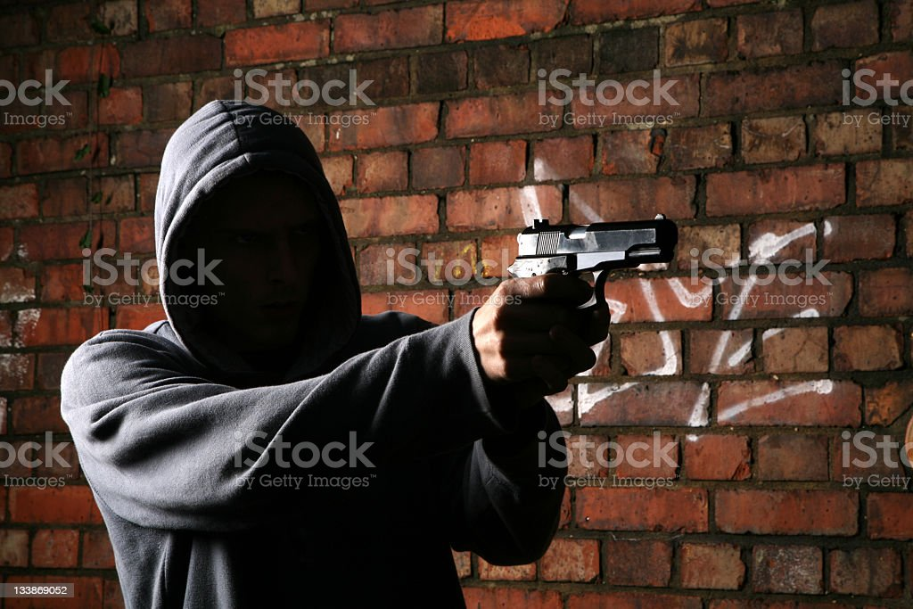 Faceless Gun Toting Hoodlum stock photo