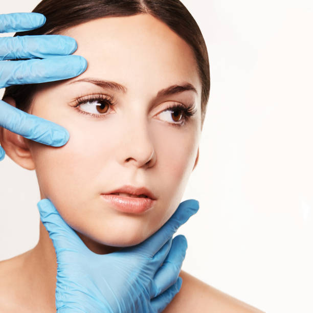 Facelift hydra treats. Esthetic skin care analysis. Doctor hands in gloves. Facelift hydra treats. Esthetic skin care analysis. Doctor hands in gloves. medicine facial beauty exam. Symmetry consult. Cosmetology wrinkle specialist. dermatologist stock pictures, royalty-free photos & images