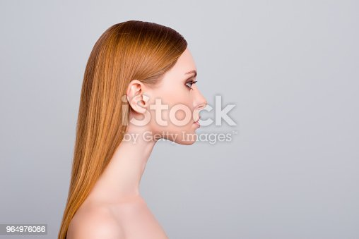 Facelift lifting nourishing bathroom hygiene correction collagen purity concept. Half-faced view portrait of charming beautiful attractive serious confident woman isolated gray background copy-space