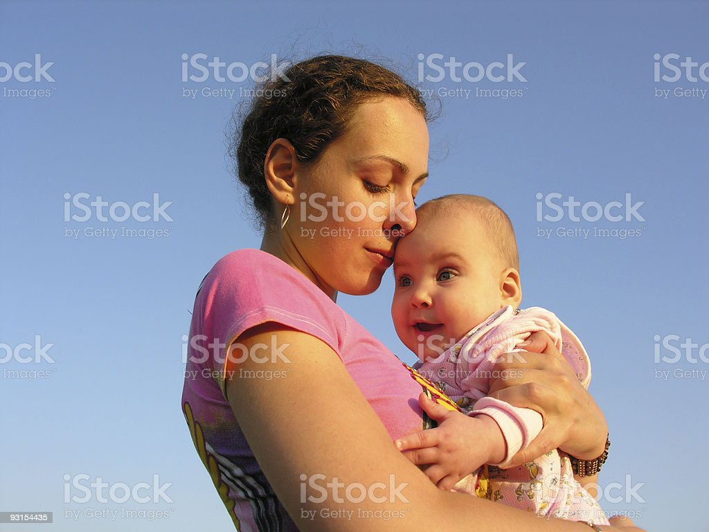 faces mother with baby on sunset touch nose stock photo