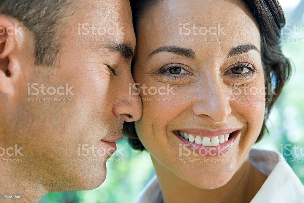Faces of a loving couple royalty-free stock photo