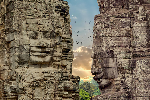 istock Faces of Bayon temple in Angkor Thom, Siemreap, Cambodia. 844477522