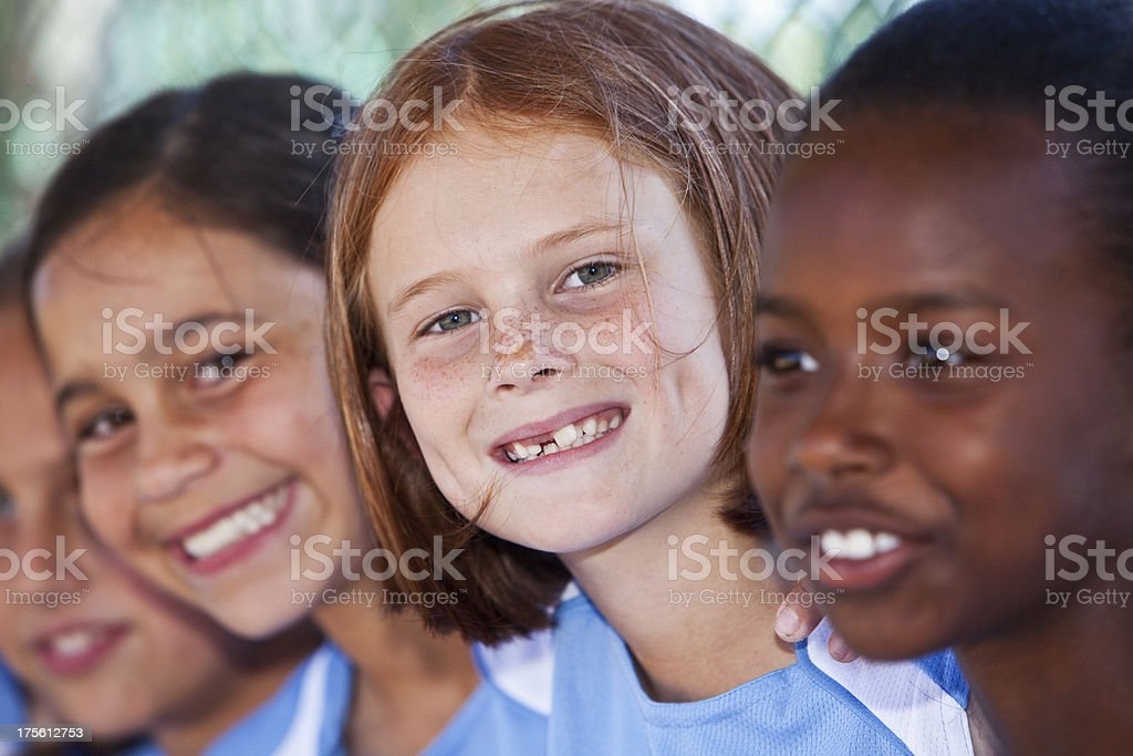 Faces of happy little girls stock photo