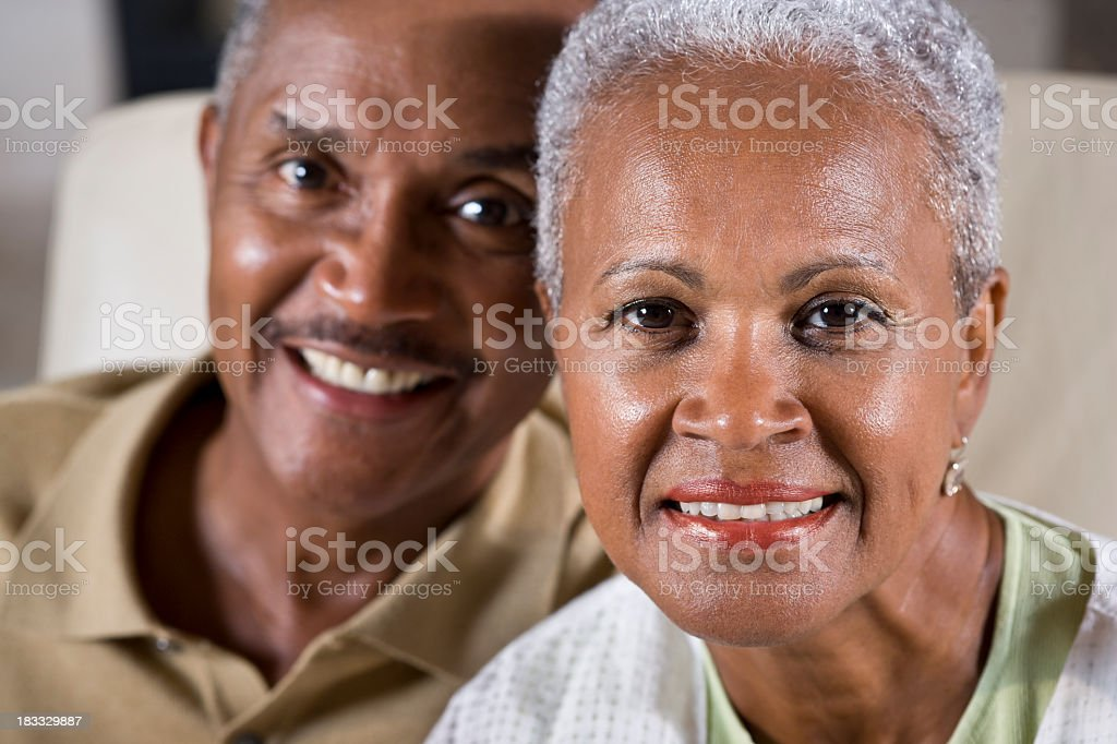 Faces of happy senior African American couple, focus on woman stock photo