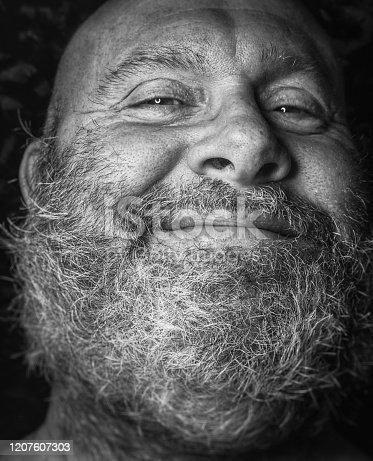 Faces of Mental Health...representing the quickly changing personalities of a man suffering from severe PTSD, paranoid schizophrenia,obsessive compulsive disorder, anxiety/panic, and depression. Mental Health Awareness, part of a series of four different faces, a large, bald and rugged looking, forty six year old, bearded man who suffers with all of the above listed mental health issues is pictured in each portrait.