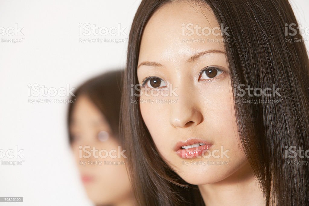 Faces of two young japanese women 免版稅 stock photo