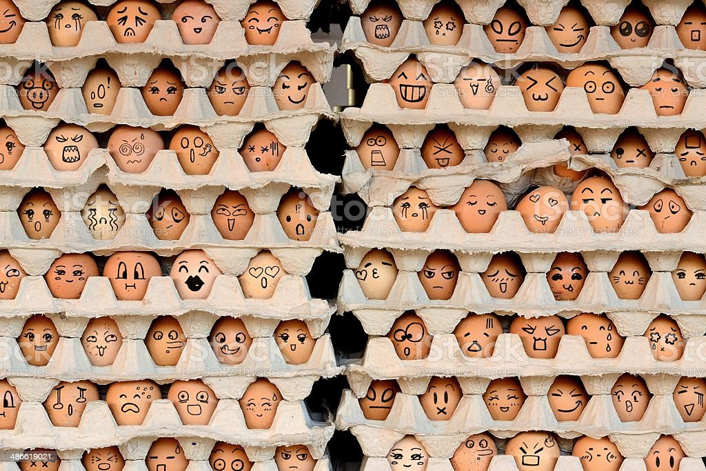 Faces on the eggs stock photo