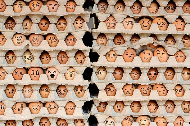 faces on the eggs - large group of objects stock photos and pictures