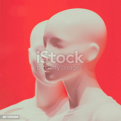 Two mannequins standing against a red background.