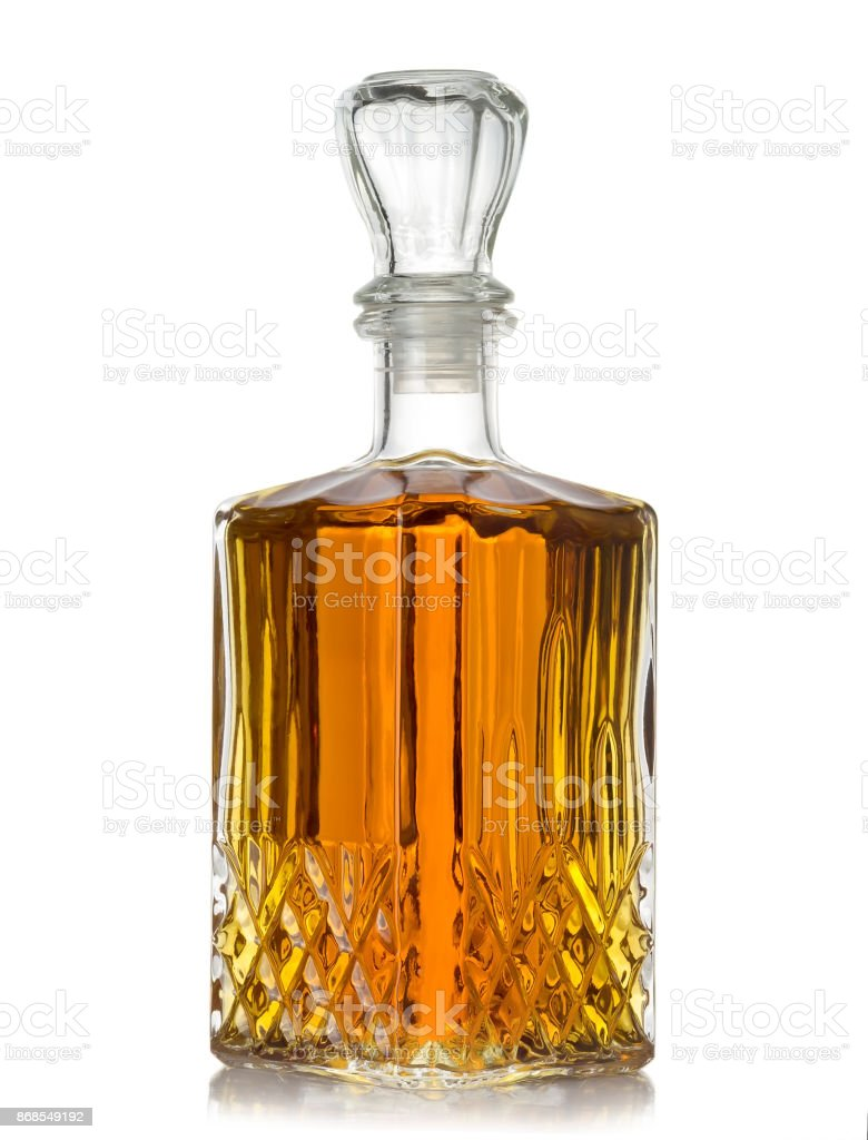 faceted bottle of cognac on white background stock photo