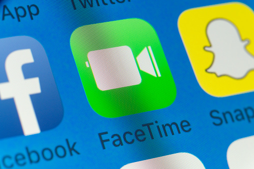 London, UK - August 01, 2018: The buttons of FaceTime, Facebook, Snapchat, WhatsApp, and Apple Music on the screen of an iPhone.