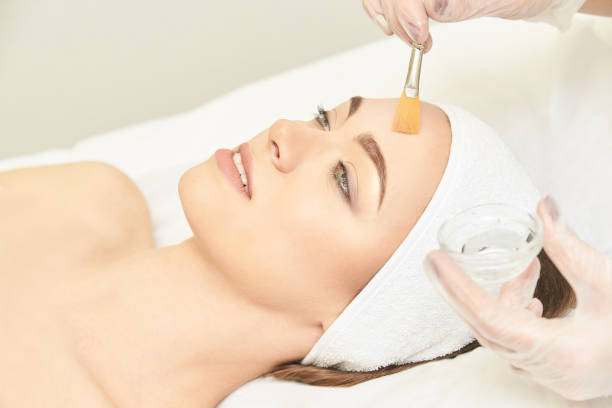 facial brush peel retinol treatment. beauty woman peeling procedure. cosmetology young girl therapy.hyaluronic acid - chemical peel stock pictures, royalty-free photos & images