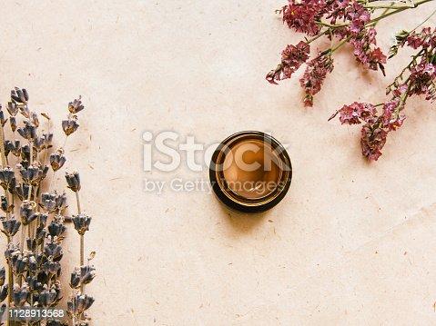 1128479585 istock photo Facial cream Top view photo 1128913568